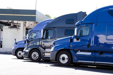 Modern semi trucks profiles on truck stop