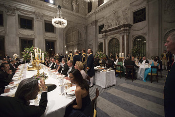 Guests wait for the arrival of Turkey's President Abdullah Gul and Netherlands' Queen Beatrix for the state banquet at the royal palace in Amsterdam