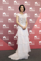 Actress Huang poses during 68th Venice Film Festival