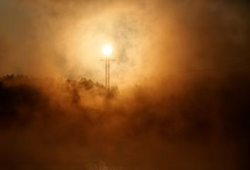 View shows mast of high-voltage electric line during sunset outside Krasnoyarsk