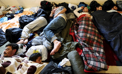 Migrants from Syria and Afghanistan sleep inside a mosque in Kumanovo
