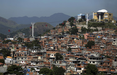 Cable cars are seen over the Complexo do Alemao slum in Rio de Janeiro