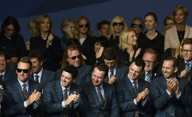 Team Europe players applaud during the opening ceremony of the 40th Ryder Cup at Gleneagles