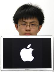 Hong Kong design student Jonathan Mak poses with a symbol in Hong Kong
