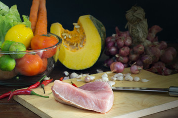 Pork and vegetables prepared for cooking on the table in the kitchen / Still life image and select focus..