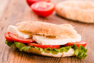 Puccia bread with mozzarella and tomato.