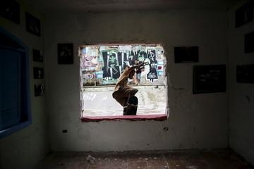 Skateboarder Diego rides board in skate park house in Itanhaem