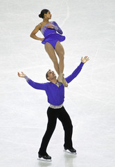 Evora is thrown into the air by Ladwig during the pairs free skate program at the U.S. Figure Skating Championships in Greensboro