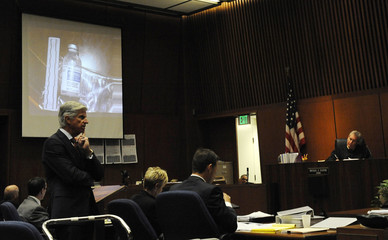 A picture of a propofol bottle found in Michael Jackson's home is projected onto a screen during a trial in Los Angeles