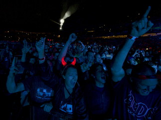 A fan of veteran rock band AC/DC wears flashing devils horns during the band's first concert in Australia on their 'Rock or Bust' world tour in Sydney