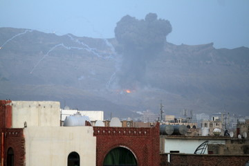 Smoke is seen at the Noqum Mountain after it was hit by an air strike in Yemen's capital Sanaa