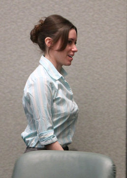 Casey Anthony smiles as she leaves the courtroom during a recess during day 19 of her 1st -degree murder trial at the Orange County Courthouse, in Orlando Florida