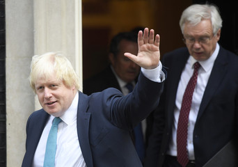 Britain's Foreign Secretary Boris Johnson waves as he leaves 10 Downing Street after a cabinet meeting with David Davies, secretary of state for exiting the European Union, in London