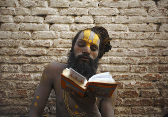 Hindu holy man, or sadhu, recites holy book of Ramayana the eve of Shivaratri festival at premises of Pashupatinath Temple in Kathmandu
