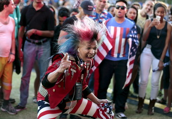 Faroh dances during an Independence Day celebration at Grand Park in Los Angeles, California