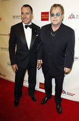 "Musician Elton John and his partner David Furnish arrive for the Elton John Aids Foundation charity event ""An Enduring Vision 2012"" in New York"