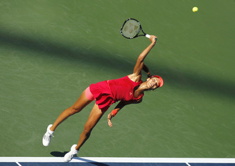 Ana Ivanovic of Serbia serves to Ksenia Pervak of Russia during their match at the U.S. Open tennis tournament in New York