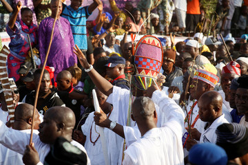 Ooni of Ife Enitan Adeyeye Ogunwusi wears a crown as he walks through a crowd during the Olojo festival in Ile Ife, Nigeria