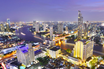 Foto op Canvas Afrika Bangkok river view at Dusk with modern business building along the Chao Phraya river ,Thailand