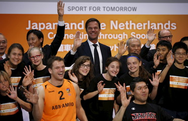 Netherlands' PM Rutte poses with Tokyo governor Masuzoe, Suzuki, the head of Japan's sports agency, students and wheelchair basketball players from Japan and Netherlands, during a photo session at a wheelchair basketball demonstration event in Tokyo