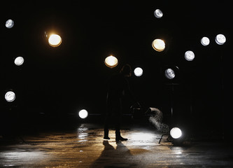 A man sprays water on runway before start of 3.1 Phillip Lim Autumn/Winter 2013 collection during New York Fashion Week