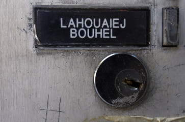 The name Mohamed Lahoualej Bouhlel is seen on a plate outside the building where he lived in Nice