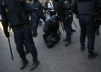 A protester is detained by Spanish riot police during a planned demonstration against the government in Madrid