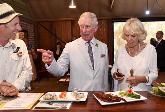 Britain's Prince Charles and his wife Camilla, Duchess of Cornwall, taste local produce at Oranje Tractor Centre during a visit to Albany