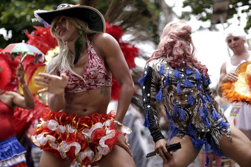 """Revellers dance during the annual block party known as the """"Virgens do Bairro Novo"""" (Virgin's new neighborhood), one of the many pre-carnival parties to take place in the neighbourhoods of Olinda"""