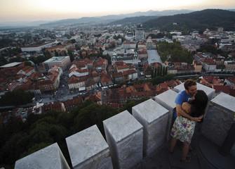 Tourists kiss on the tower of Ljubljana Castle