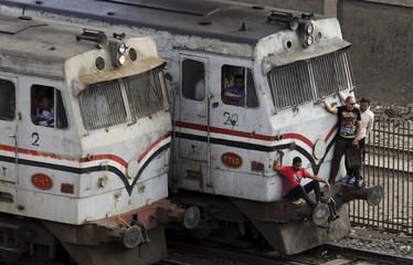 People travel on an overcrowded train in Cairo