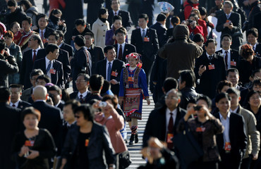 Delegates arrive for the third plenary session of the NPC in Beijing