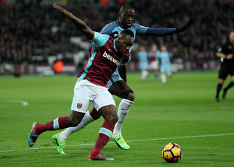 West Ham United's Michail Antonio in action with Manchester City's Yaya Toure