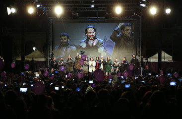 Podemos (We Can) party leader Pablo Iglesias is seen on a giant screen while addressing supporters after results were announced in Spain's general election in Madrid