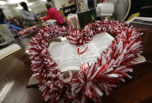 A heart-shaped wreath is seen wrapped around an open Bible in the library at Leo Catholic High School in Chicago, Illinois