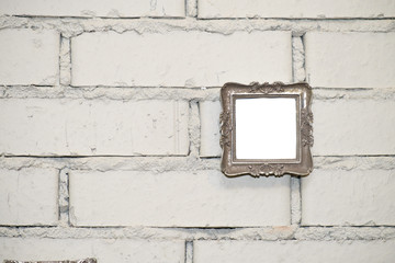 empty frame on a white brick wall