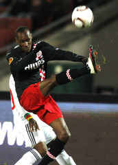 Hutchinson of PSV battles for the ball with Mbengono of Debrecen during their Europa League soccer match in Budapest