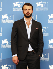"""Director De Angelis poses during the photo call for the movie """"Perez""""  at the 71st Venice Film Festival"""