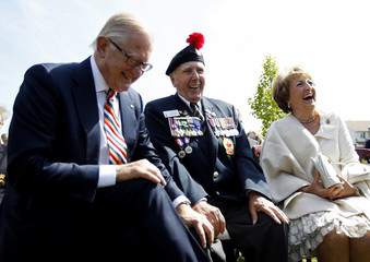 Canadian veteran Coughlin shares a laugh with Princess Margriet of the Netherlands and her husband van Vollenhoven during a ceremony in Ottawa