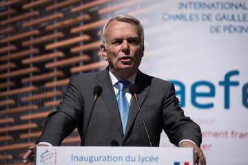 French Foreign Minister Jean-Marc Ayrault speaks in front authorities as part of his visit at the new French school for his inauguration in Beijing