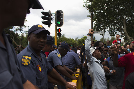 Frustrated mourners react after being denied entry to the Union Buildings where former South African President Nelson Mandela was lying in state, in Pretoria