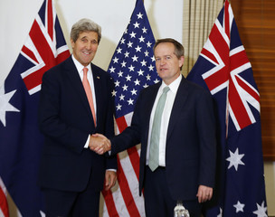 U.S. Secretary of State John Kerry shakes hands with Australia's opposition leader Bill Shorten in Sydney