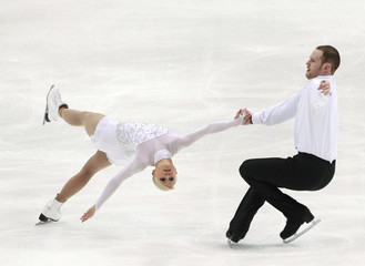 Yankowskas and Coughlin of the U.S. perform during the pairs short program competition at the ISU Four Continents Figure Skating Championships in Taipei