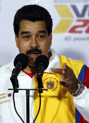 Venezuela's President Nicolas Maduro talks to the media after voting during municipal elections in Caracas