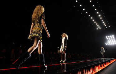 Models display creations from Just Cavalli's Autumn/Winter 2013 collection at Milan Fashion Week