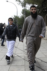 Sons of radical Muslim cleric Qatada leave following their father's trial at the State Security Court in Amman