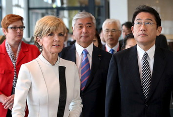 Australia's Defence Minister Marise Payne walks with Australian Foreign Minister Julie Bishop, Japan's Defense Minister Gen Nakatani and Japan's Foreign Affairs Minister Fumio Kishida during a visit to the Royal Australian Navy Heritage Centre in Sydney