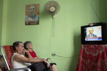 Arias and Suarez watch U.S. President Obama's statement about Cuba on television, at the Eterna Juventud retirement home in Havana