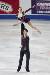 Beth Marley is lifted by her partner Brubaker during the pairs short program at the U.S. Figure Skating Championships in Greensboro