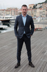 """Actor Barry Sloane poses during a photocall for the television series """"Six"""" during the annual MIPCOM television programme market in Cannes"""